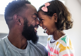 Father and daughter smiling face to face